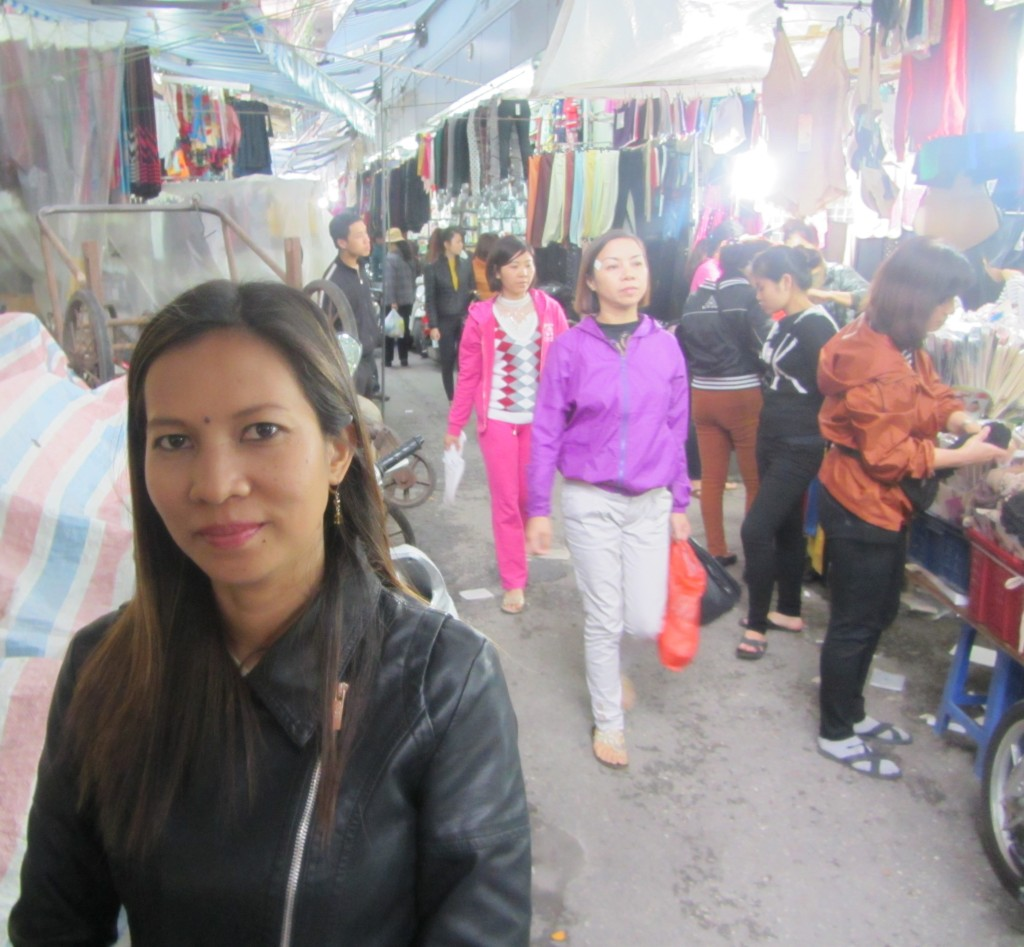 At the market. So many people, so many clothes.