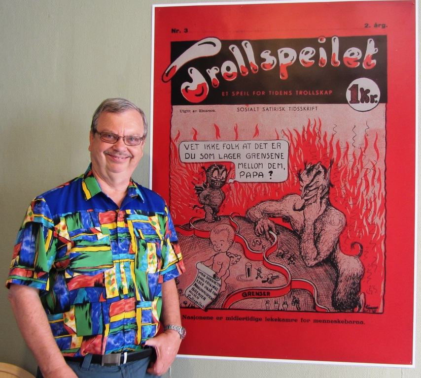 "My husband in front of the satirical magazine ""Trollspeilet"" ""The Troll Mirror"" where the son of the Devil ask his father: ""Do people know that it was you who made the borders between them?¨"