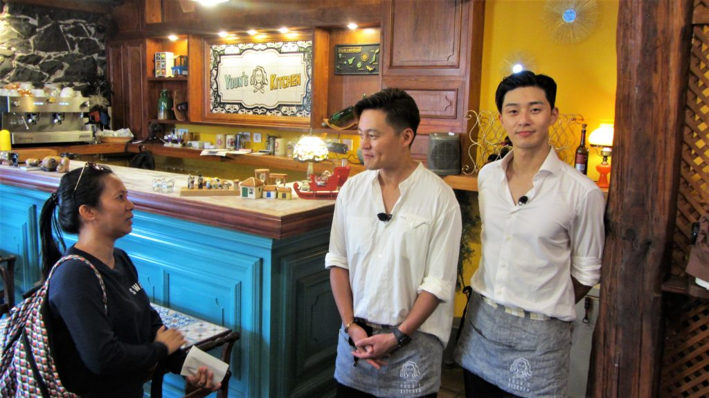 … and the waiters, Korean actors Lee Seo Jin and Park Seo Joon