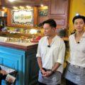 … and the waiters, Korean actors Lee Seo Jin and Park Seo Joon